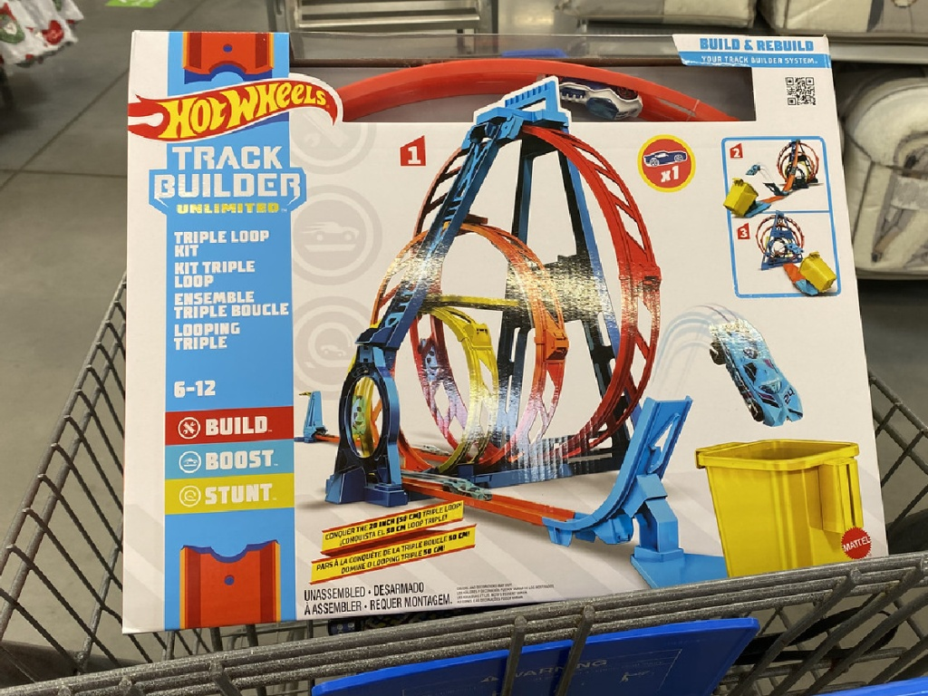shopping cart with box containing cars and tracks