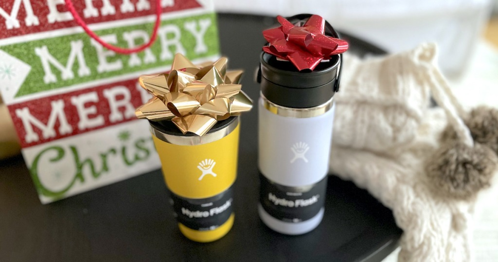 yellow and purple hydro flask mugs with christmas bows