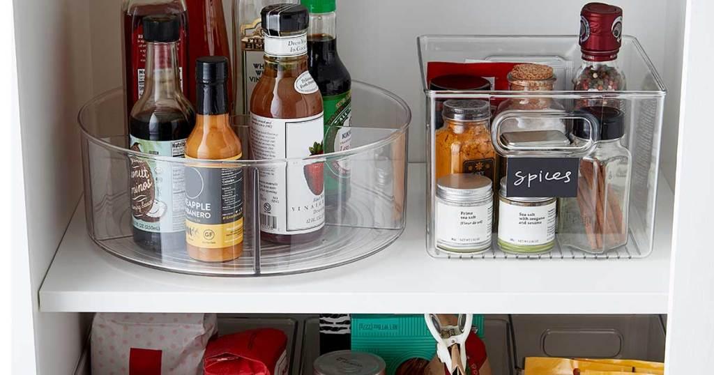 clear organizer bins inside a pantry