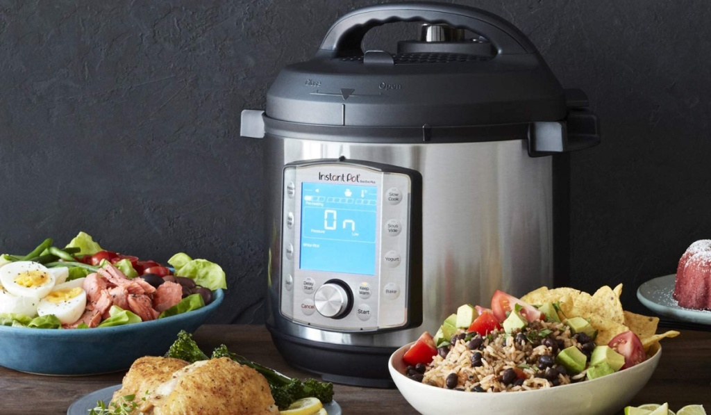 instant pot duo evo near dishes of food