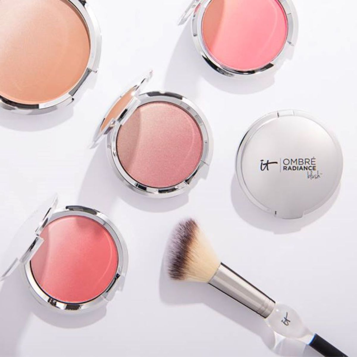 row of blushes with a brush