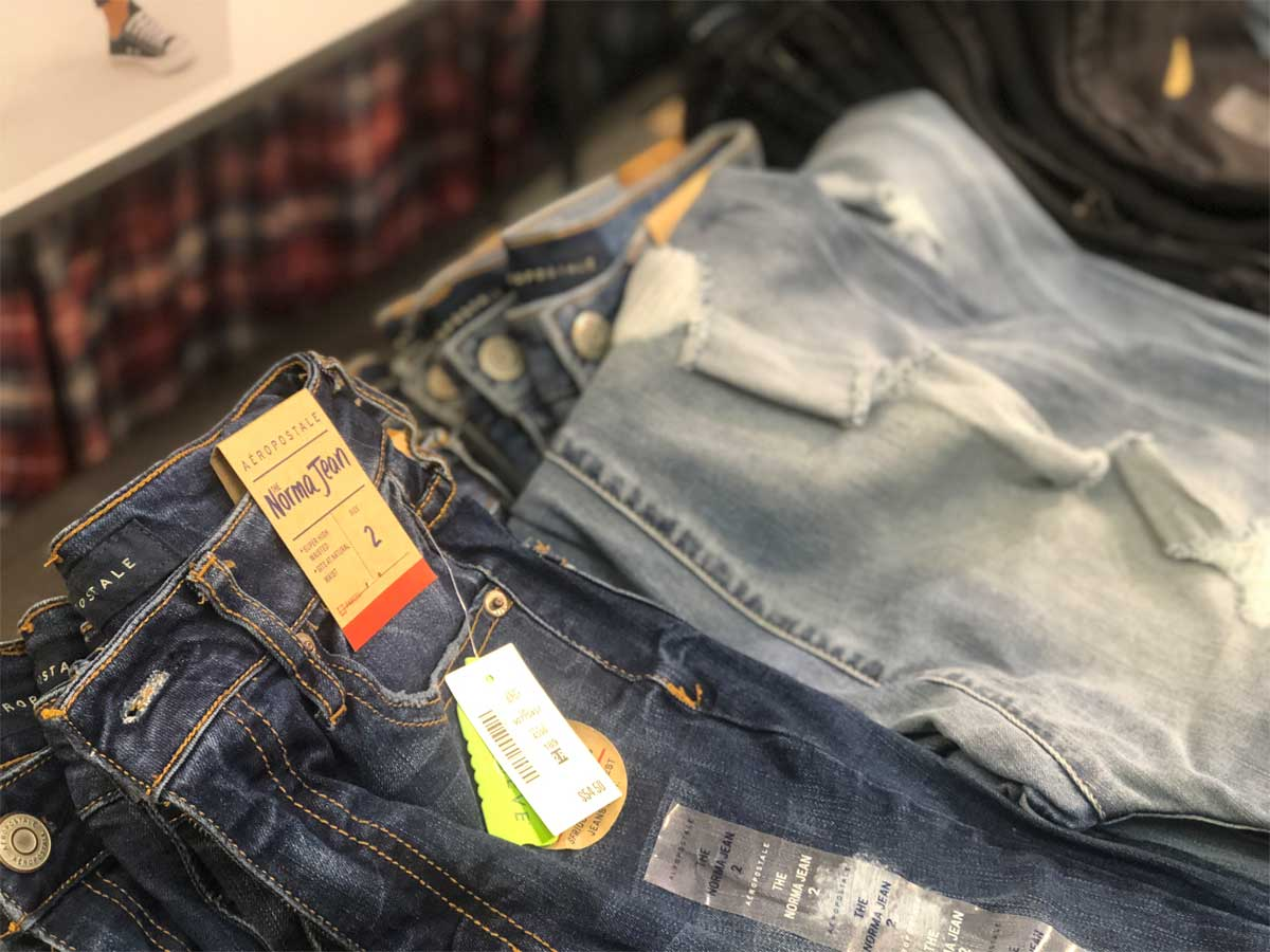 jeans folded on a table in a store
