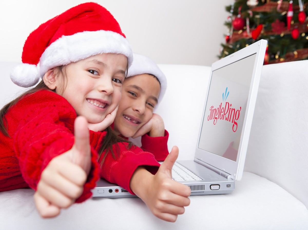 two girls in Santa hats showing thumbs up using jinglering for how to call santa