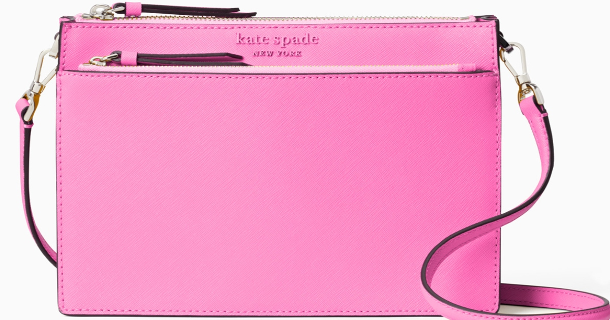 Pink Kate Spade Cameron bag with two top zippers and a long strap