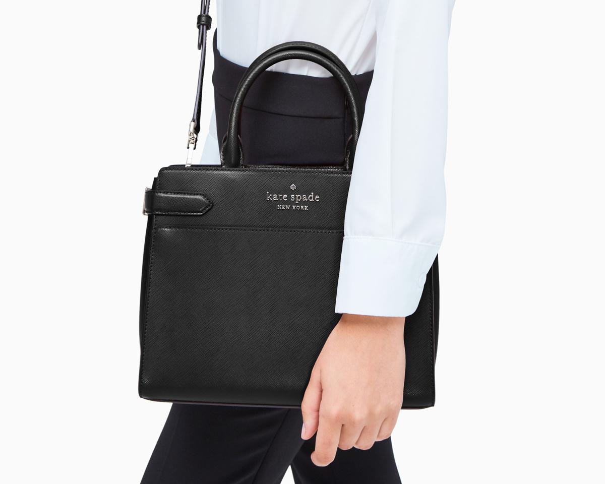 kate spade staci satchel black on womans arm