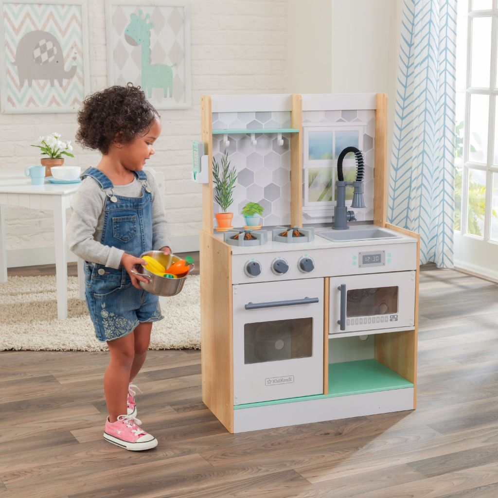 girl playing with kidkraft lets cook play kitchen