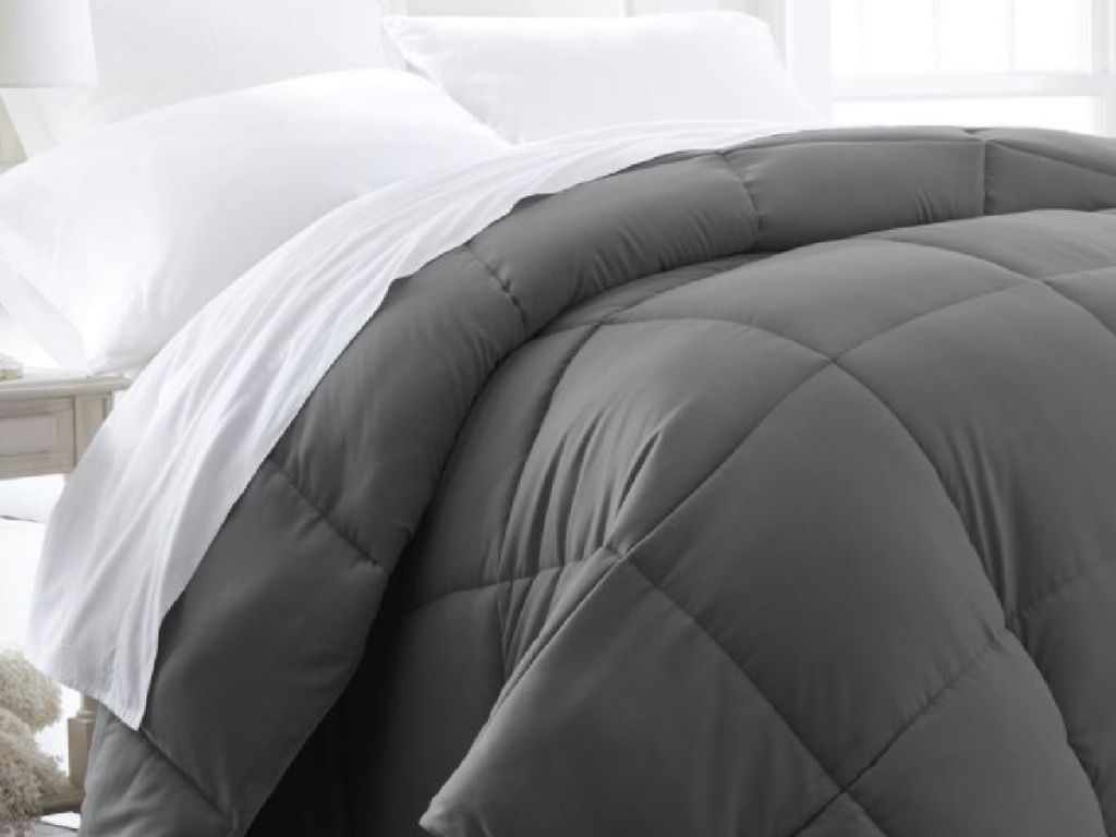 grey comforter on bed
