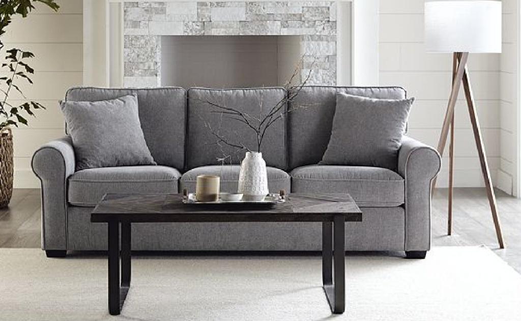 living room with grey couch and coffee table