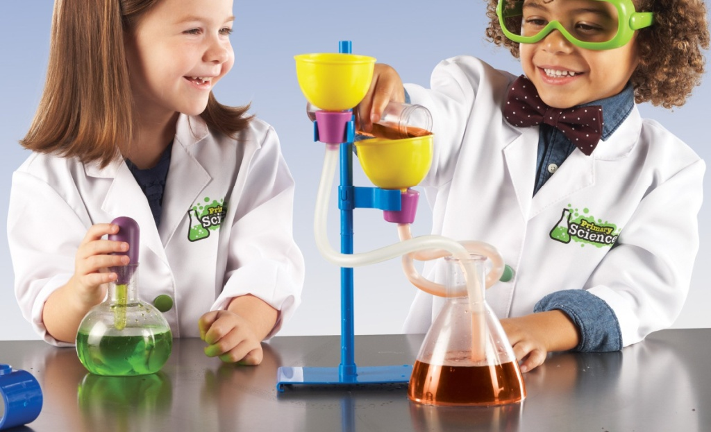 two kids playing with learning resources deluxe science kit
