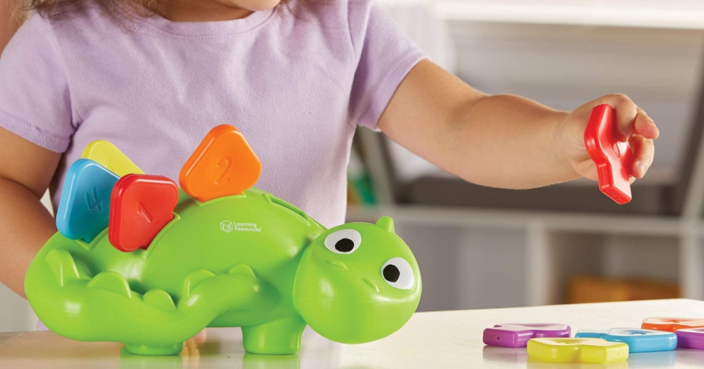 learning resources dino with little girl playing