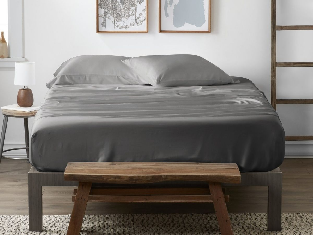 gray bamboo sheets and pillows on bed in bedroom