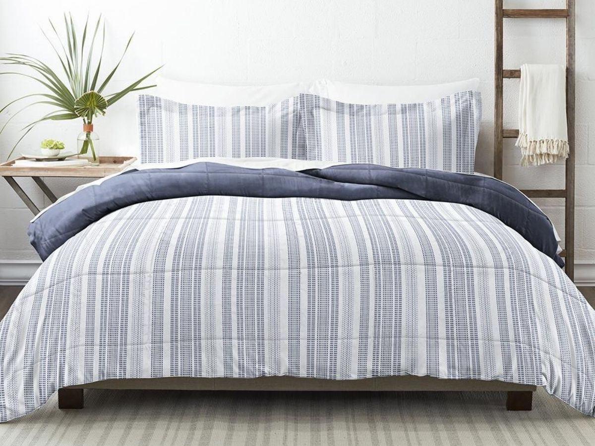 blue gray and white striped comforter on bed