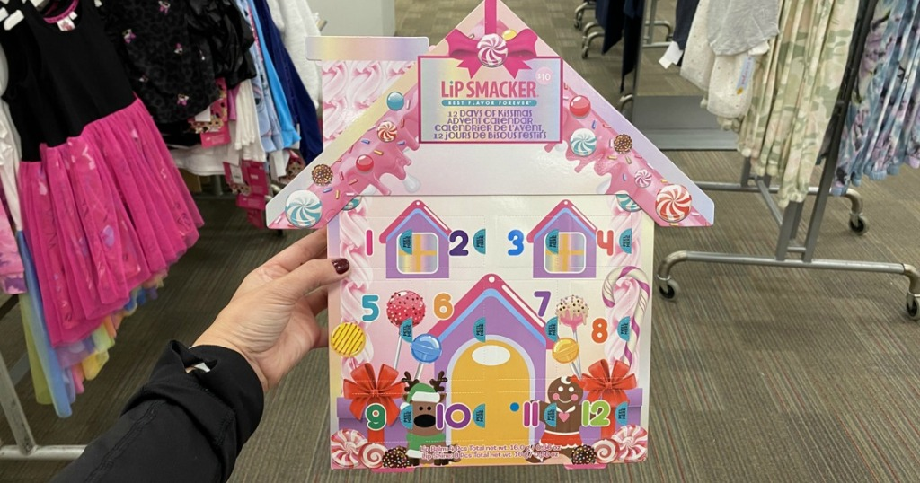 woman holding a lip smacker advent calendar in-store
