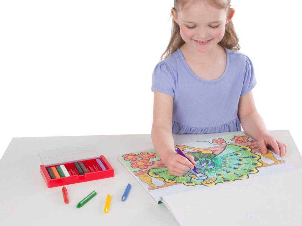 little girl coloring in a jumbo coloring book