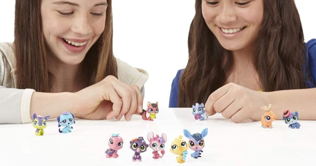 girls playing with littlest pet shop