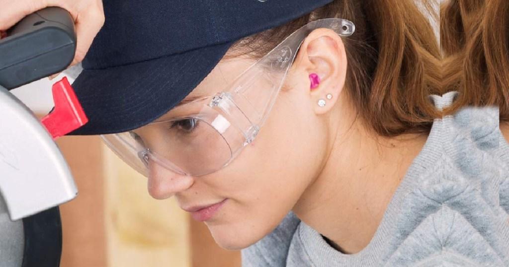 macks ear plugs in womans ear