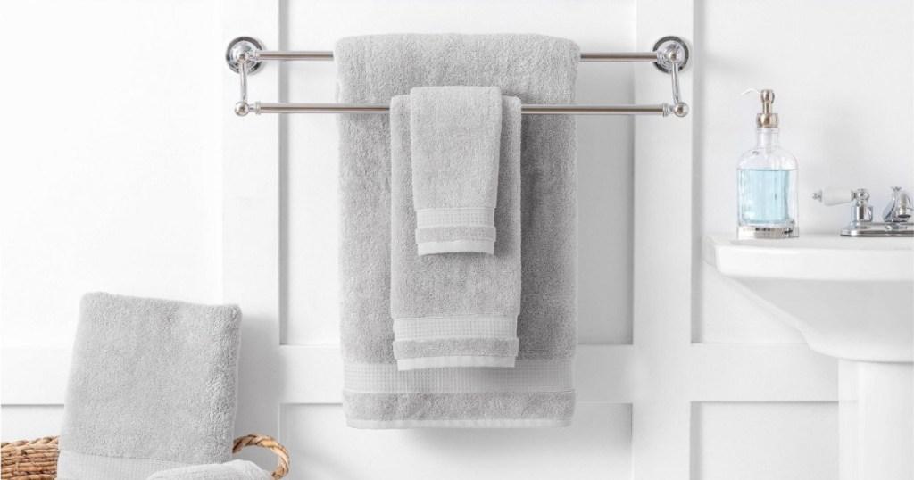 martha stewart towels hanging on rack