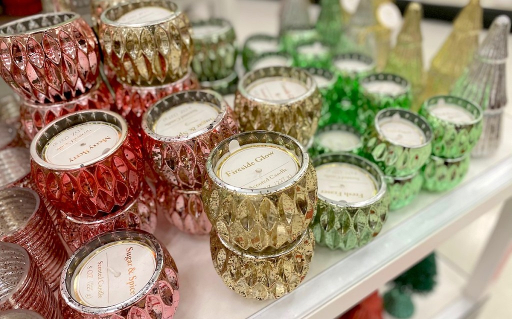 red gold and green mercury glass candles on store display table