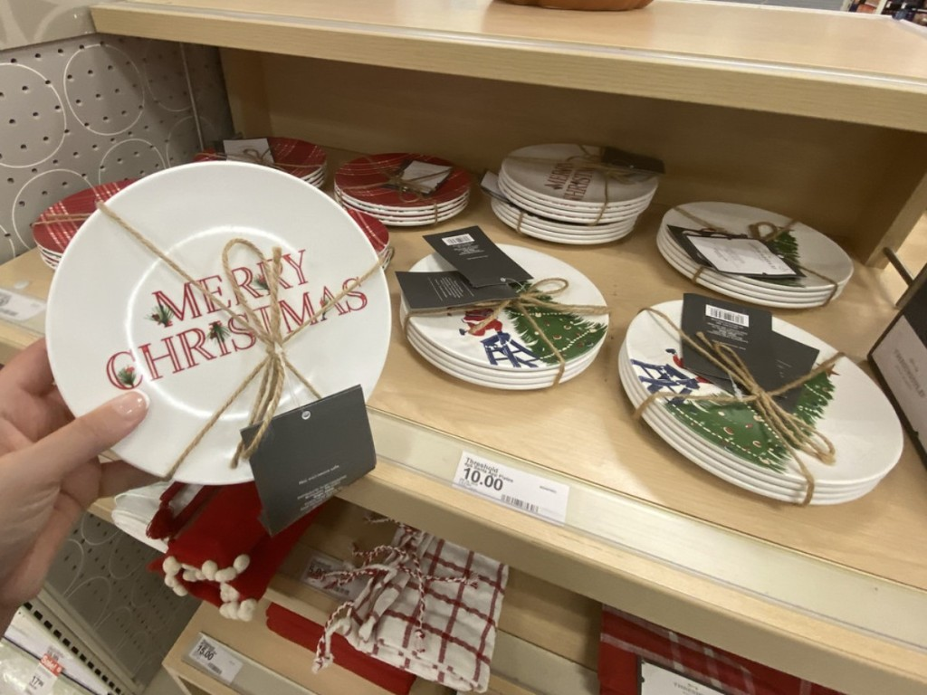 holding Christmas appetizer plates