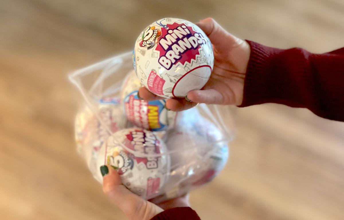 hand holding mini brands ball from ziploc bag