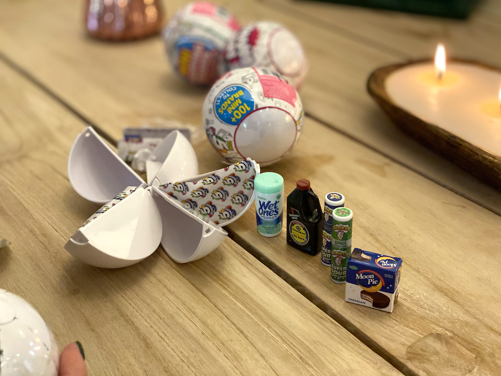 Mini brands ball and miniature brand products on table