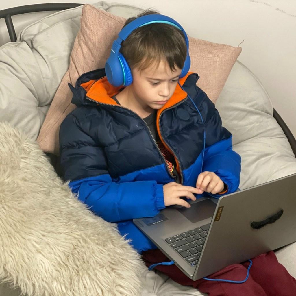 boy on laptop wearing headphones