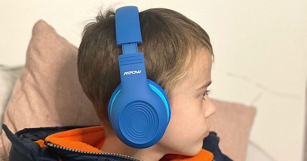 side view of boy wearing blue headphones