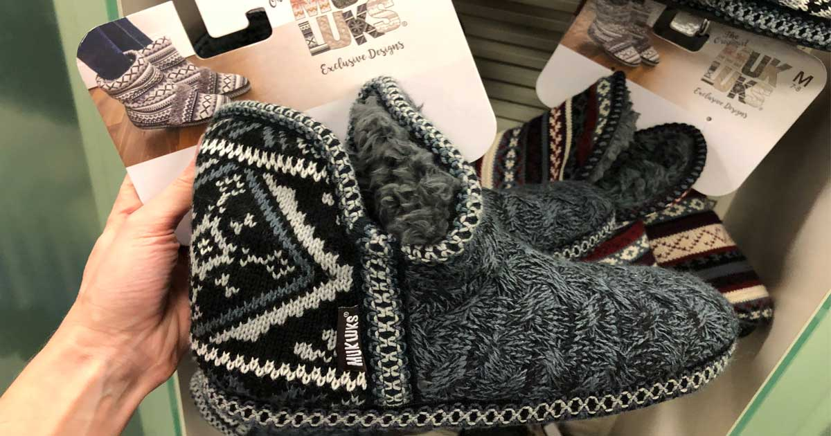 hand holding up a pair of slipper boots