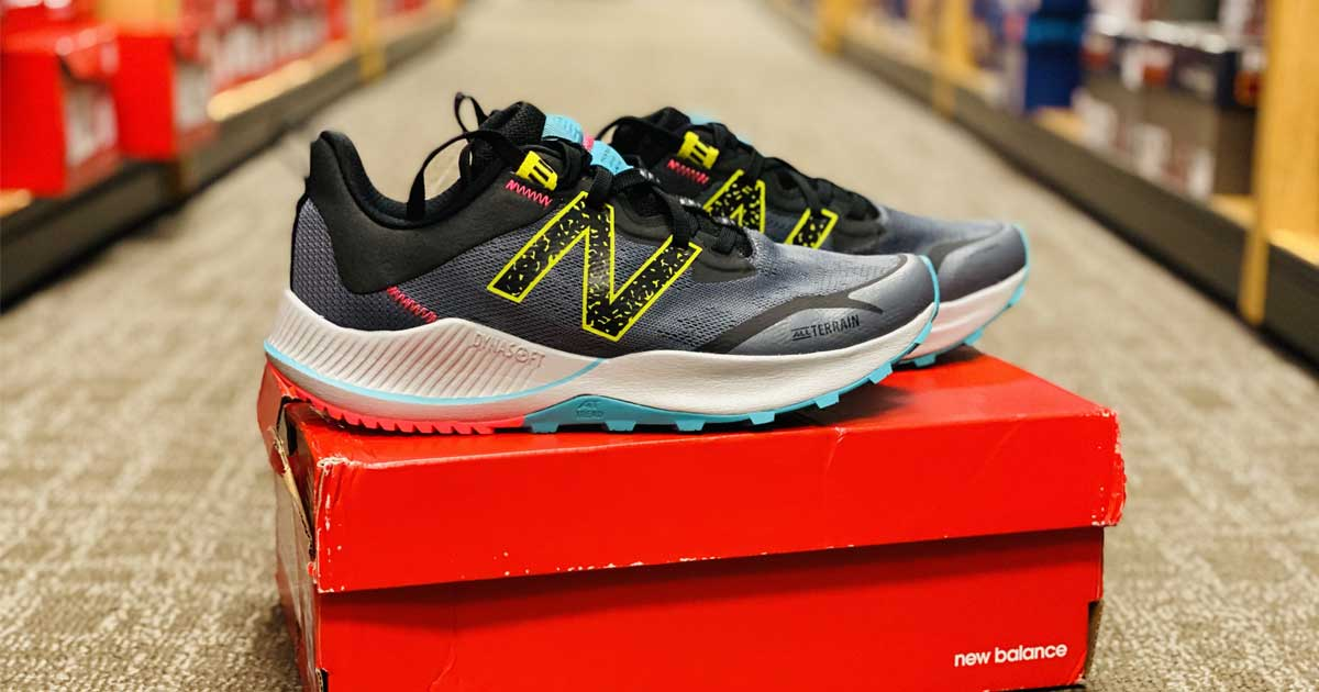 women's running shoes on box in aisle of store