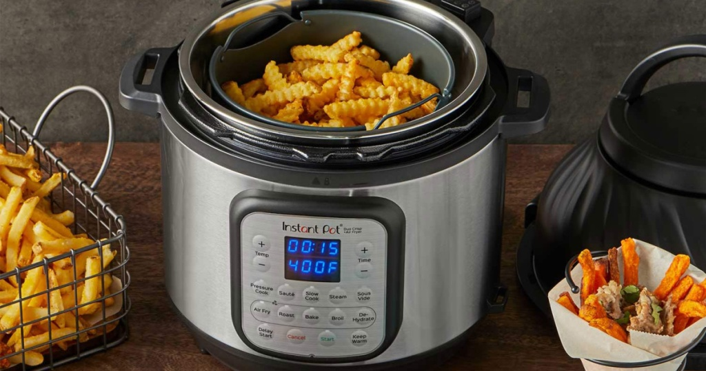 Instant Pot Air Fryer filled with fries on table, basket of fries, and black lid