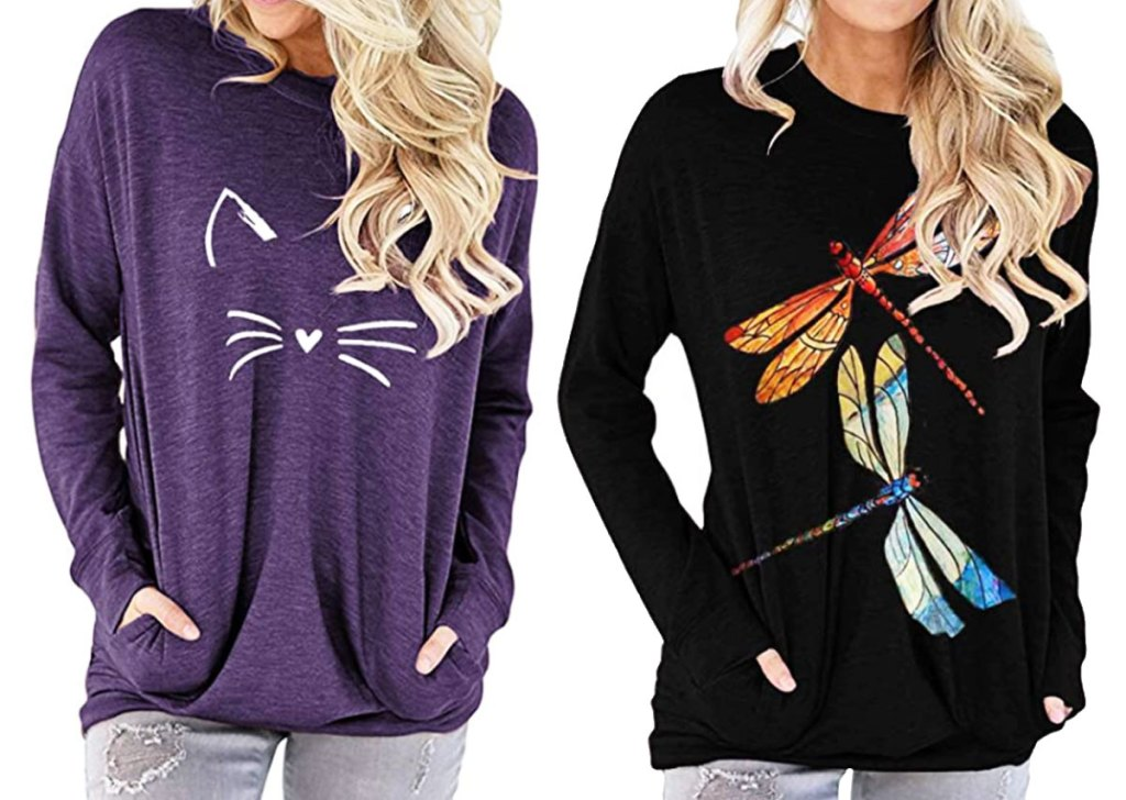 two women modeling long sleeve tees with pockets in purple with white cat face and black with dragonflies graphic