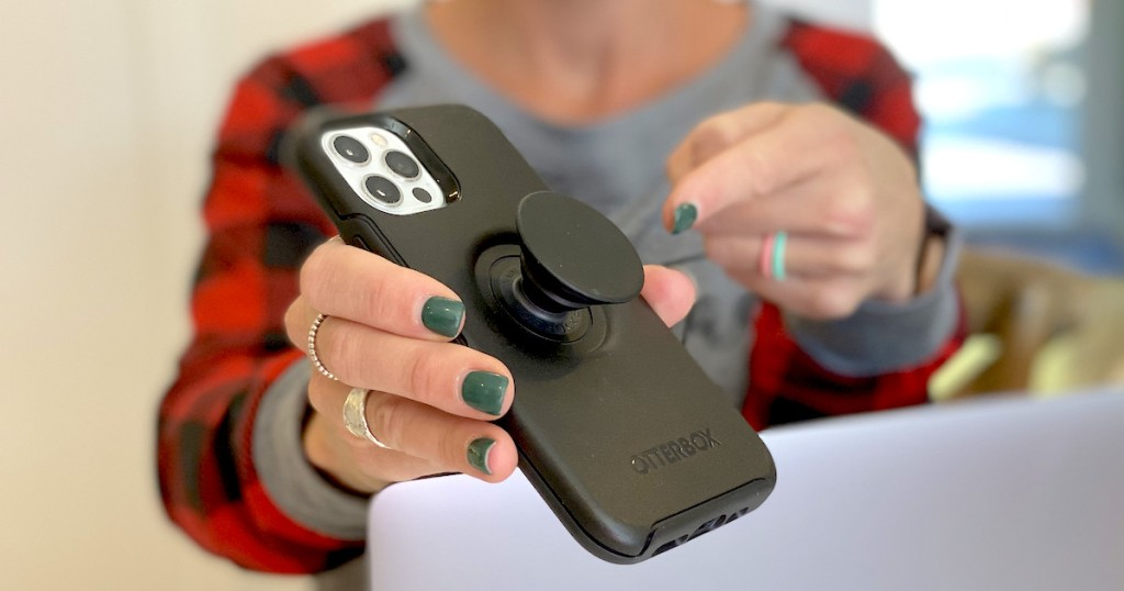 woman holding iphone with black case