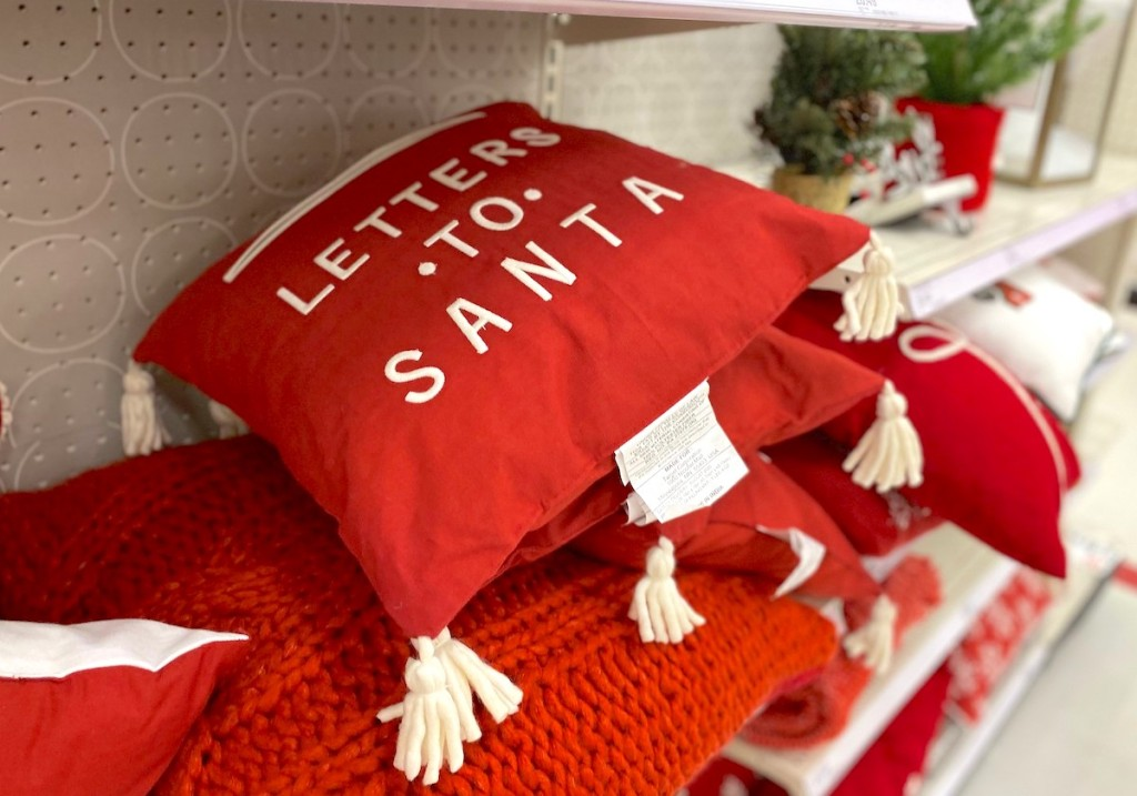 letter to santa red pillow sitting on store shelf