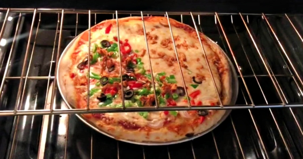 pizza on pizza pan in oven
