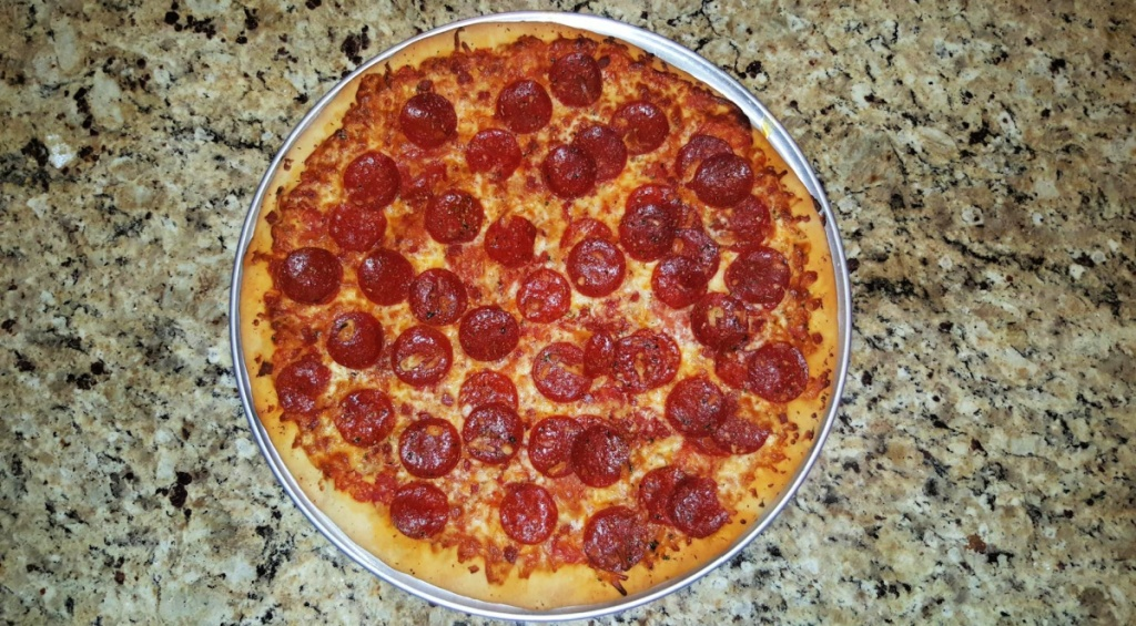 pizza pan with pepperoni pizza