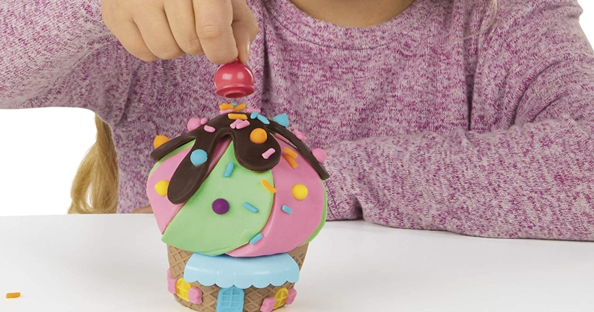 child playing with play doh ice cream set