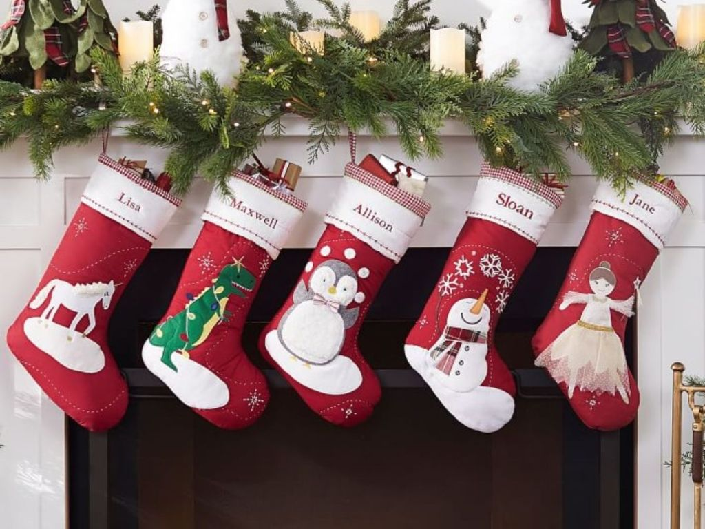 Christmas stockings filled and hanging on mantle