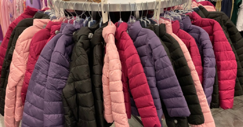 round jacket hanging system in store with kids jackets