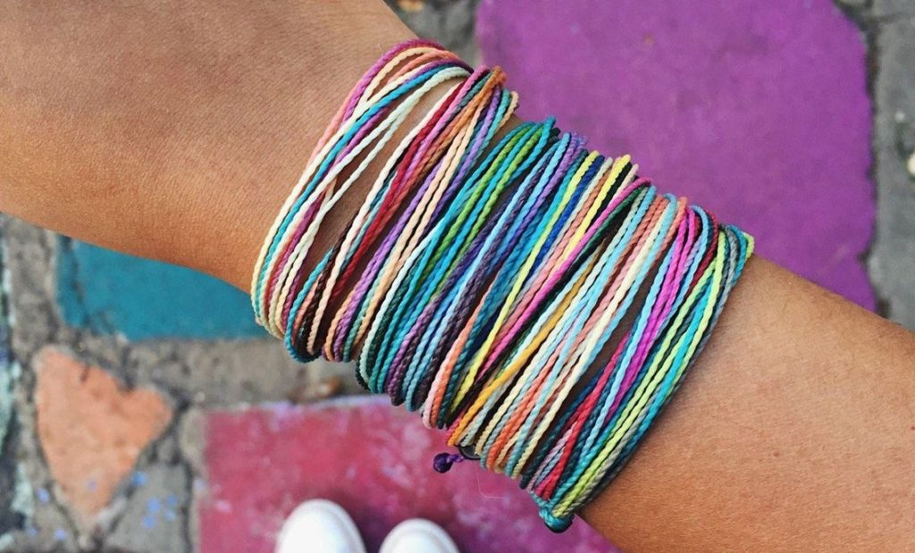 pura vida friendship pack on girls wrist
