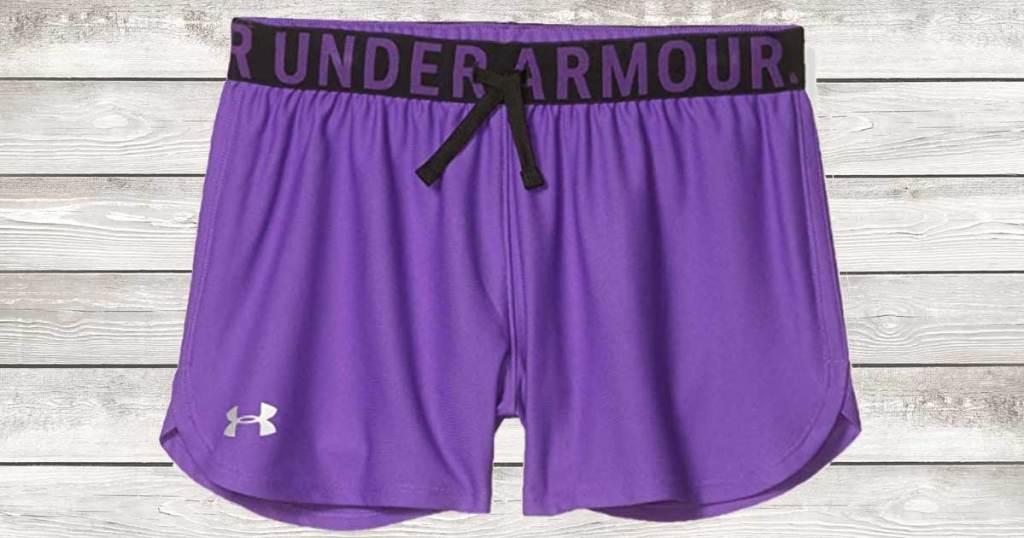 celana pendek olahraga gadis ungu