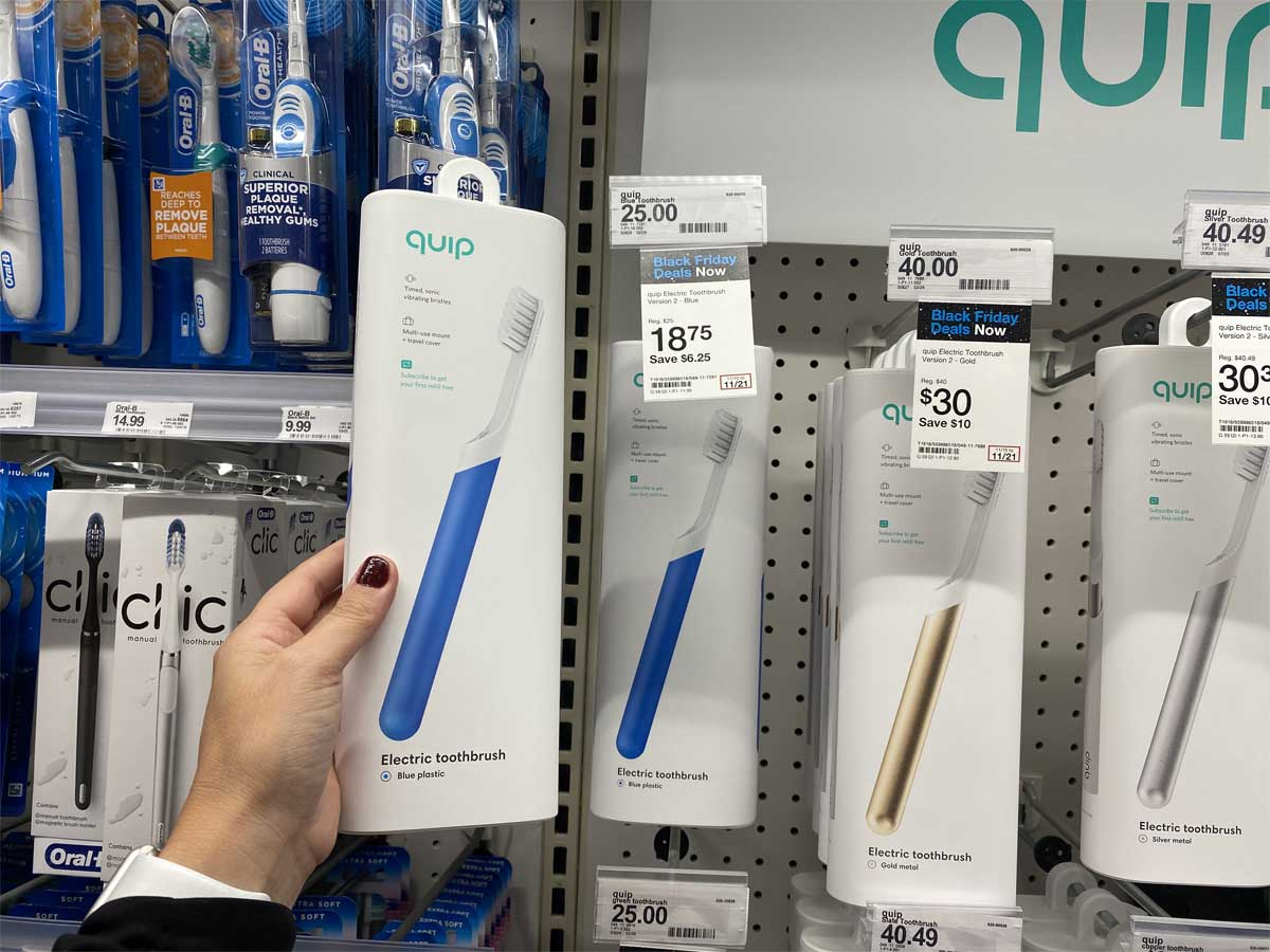 hand holding up an electric toothbrush