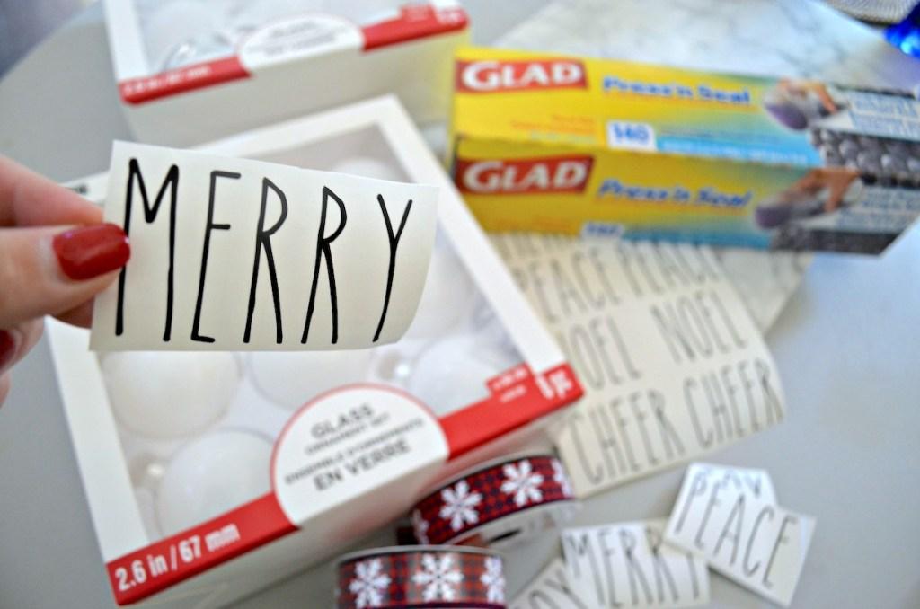 hand holding merry sticker