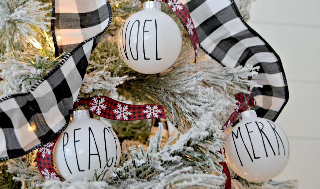 rae dunn ornaments hanging on flocked christmas tree