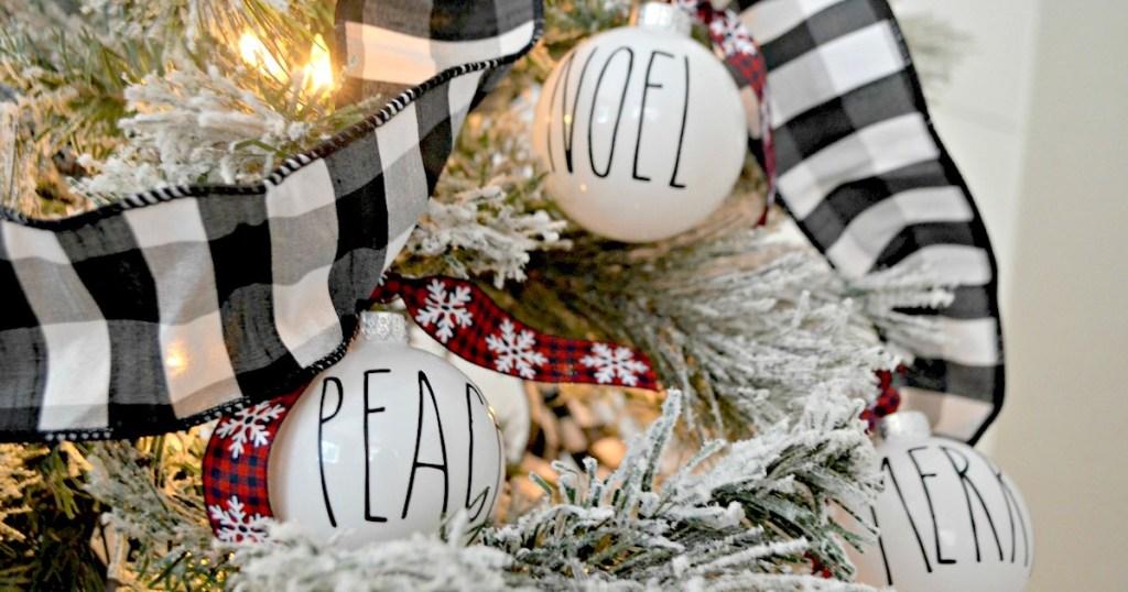 hanging christmas ornaments on tree
