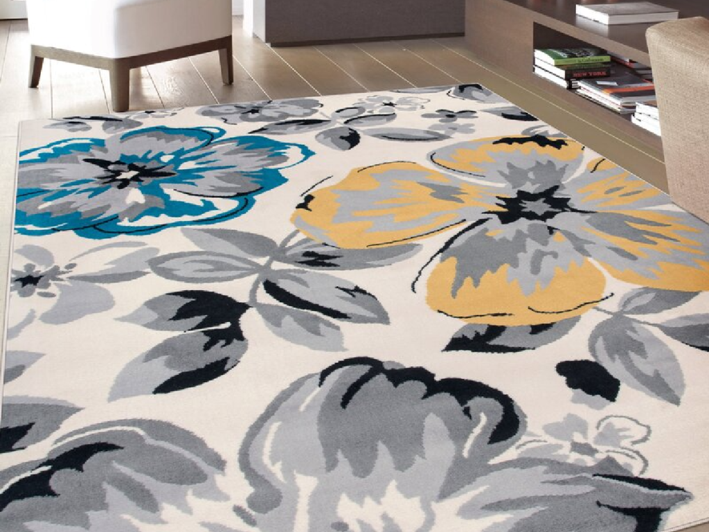 large rug with flowers on it in living space