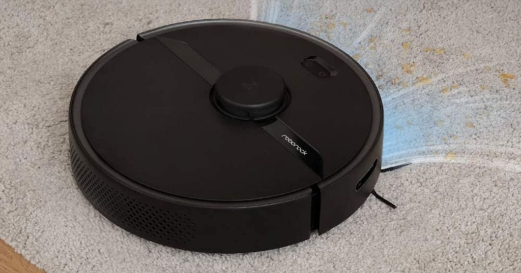 black roborock vacuum cleaning carpet