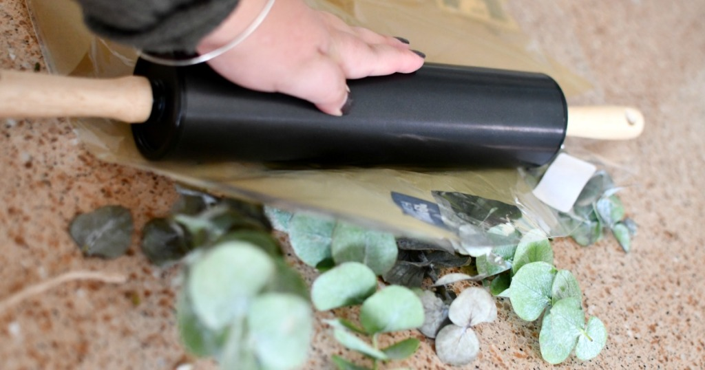 rolling eucalyptus leaves with a rolling pin