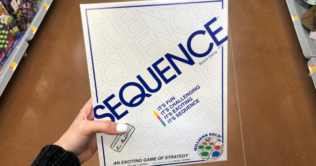 sequence board game in hand in store