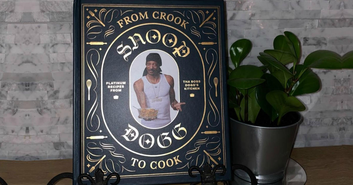 snoop dogg cookbook on display next to a potted plant