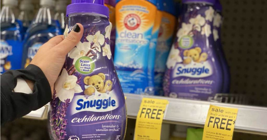 hand holding a Snuggle fabric softener
